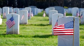 Gravestones with American flags