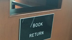 Library book return slot and sign