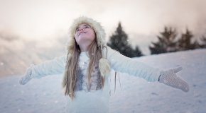 Girl in white in snowy landscape