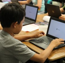 Boy using Chromebook